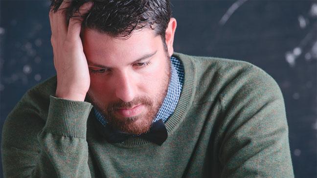 Triest kijkende leraar