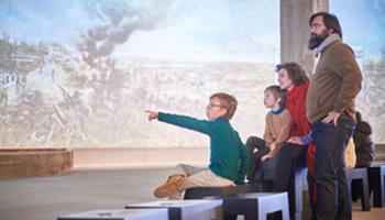 kinderen spelen interactief computerspel in Westfront