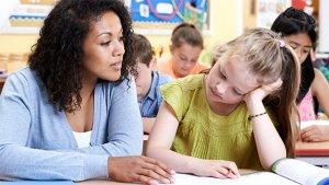 leraar met leerling