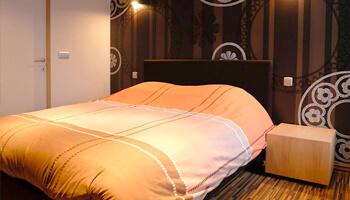 Slaapkamer van Vakantiewoning Loft in Peace