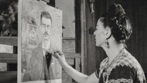 Foto van Frida Kahlo aan het schilderen