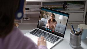 leraar in online groeigesprek meet leerling
